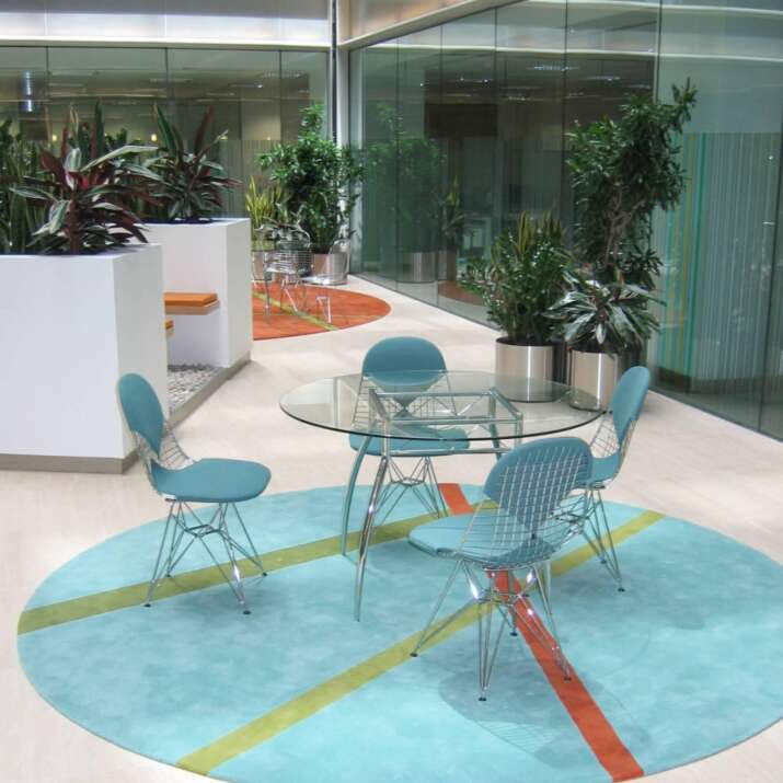 Circular atrium reception area rug in turquoise